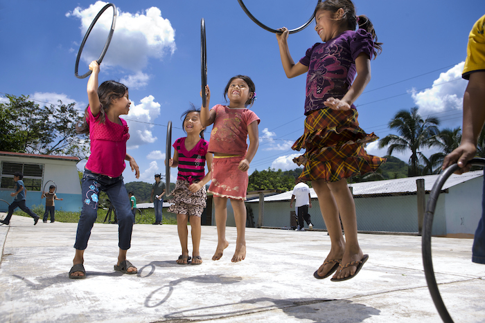Children play with hula hoops in Chiapas, Mexico