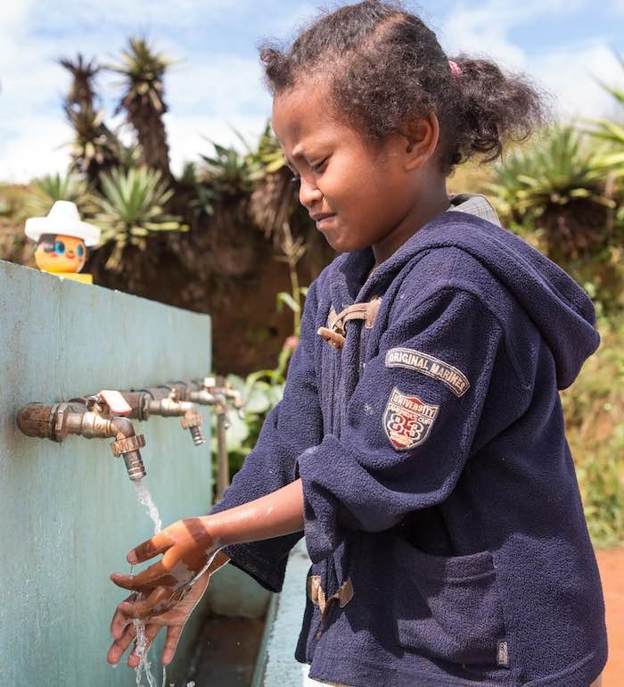 A girl washes her hands at a one of several taps at Lohanosy Primary School in Analamanga Region, Madagascar.