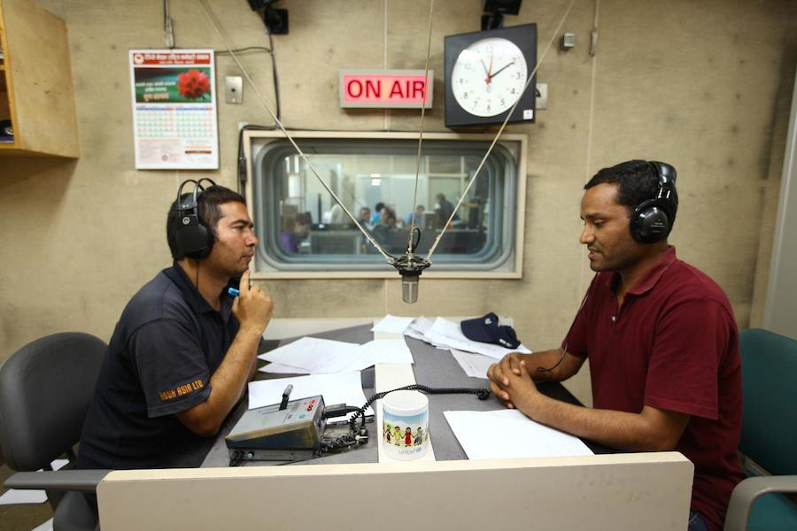 Nepal Earthquakes 2015: anchor Janardan Bista speaks live with Dr. Shaligram Bhattarai during a segment of the new UNICEF-supported 'Bhandai-Sundai' (Listening-Talking) radio program, which is being broadcast from national radio station Radio Nepal.