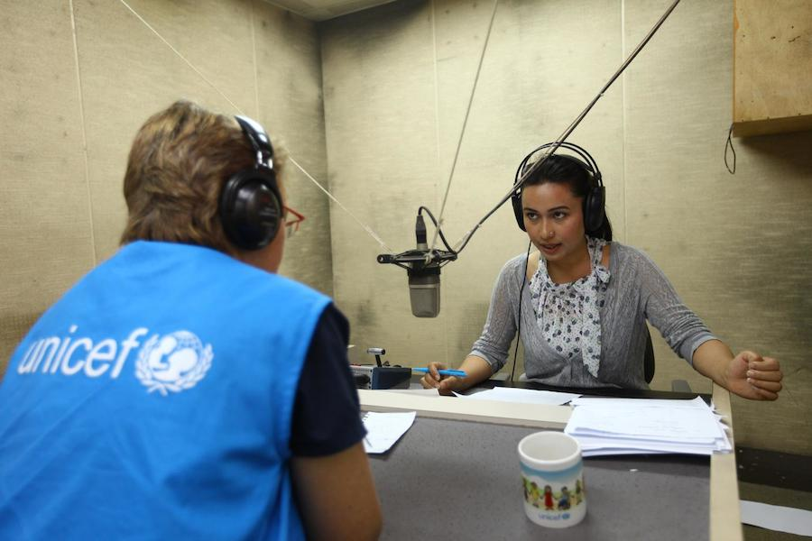 Nepal Earthquakes 2015: Anchor Archana Gurung, speaks with UNICEF staff member Natalie Fol during a segment of the new UNICEF-supported 'Bhandai-Sundai' (Listening-Talking) radio programme, which is being broadcast from national radio station Radio Nepal