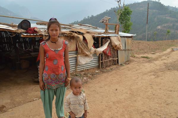 Saraswati Saru Magar and her nephew, outside a temporary shelter in Sitalpati, await UNICEF aid for Nepal