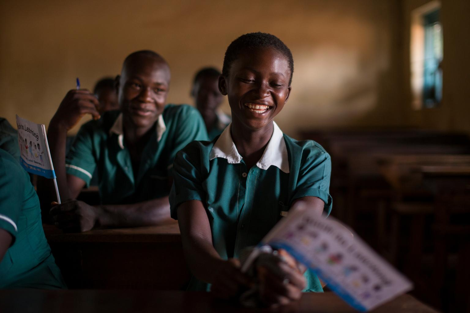A girl smiles during a class in Yambio Primary School in Yambio County, in Western Equatoria State, following the launch of the Back to Learning campaign. © UNICEF/NYHQ2015-1518/McIlwaine