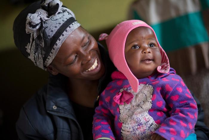Siphiwe Khumalo, 37, and her newborn baby, Lundiwe, in South Africa in 2014.