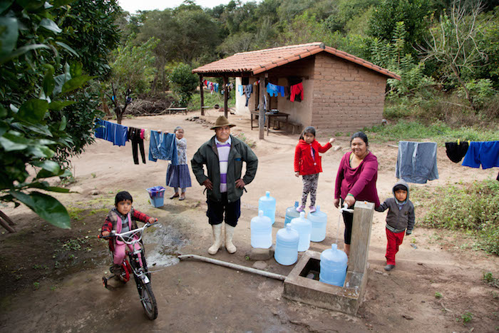 Thanks to UNICEF support this family in Bolivia is able to get water from a community tap near their home.