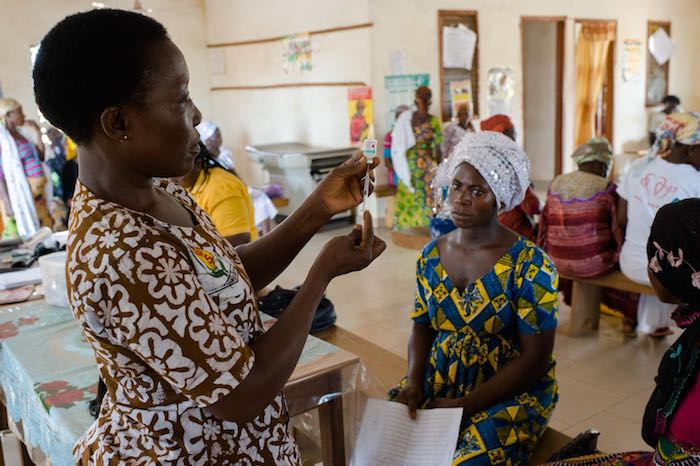 Emelia Kakarba preparing to administer a tetanus vaccine to Sadia Issah at an antenatal clinic at a Reproductive and Child Health facility in Savelugu in the Northern Region of Ghana