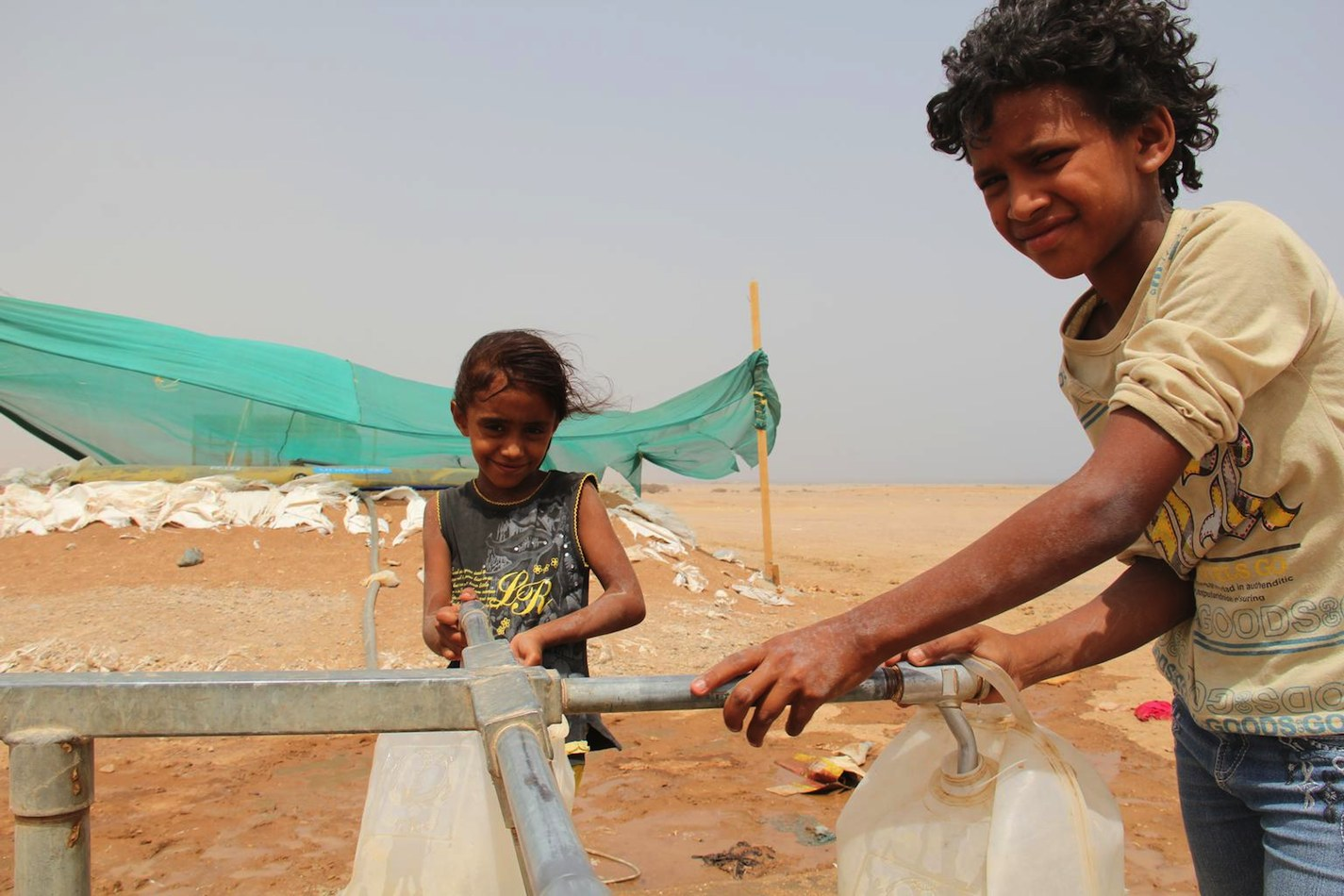 11-year-old Adam, a refugee from Yemen's terrible conflict, fetches water from a UNICEF-installed pump at the Markazi refugee in Obock, Djibouti.