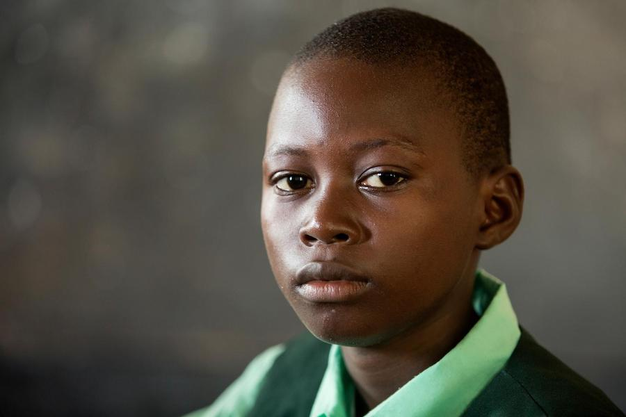 Jan, 13, lives in Waterloo, Sierra Leone. He wants to be a scientist when he grows up.