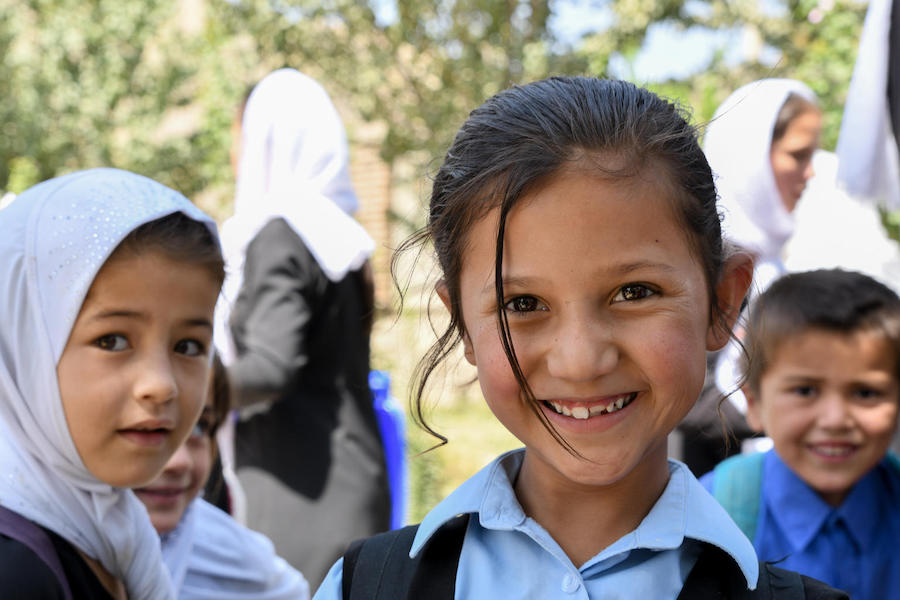 Primary students on the playground at UNICEF-supported Turgani High School in Faizabad, a northeastern province of Afghanistan, in August 2019.