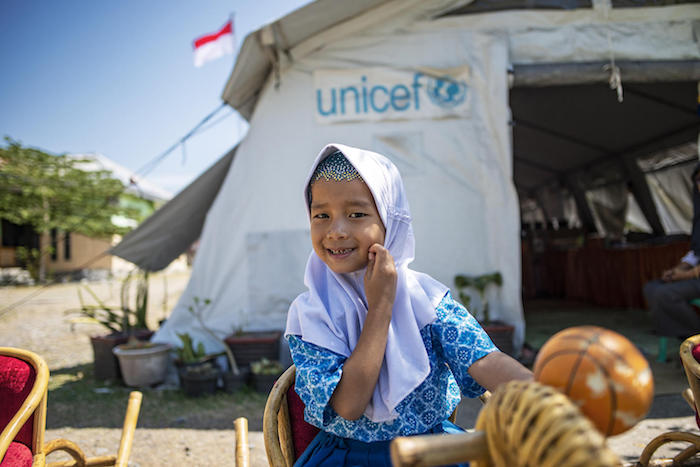 Novia, 5 plays in front of the UNICEF tent during a lunch break at TK Negeri Pembina Marawola (Kindergarten) in Marawola sub district, Sigi, Central Sulawesi, Indonesia.