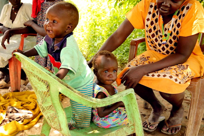 After eight weeks of UNICEF-supported treatment for severe acute malnutrition, 10-month-old Akot (left) and 16-month-old Adut are thriving in Aweil, South Sudan.