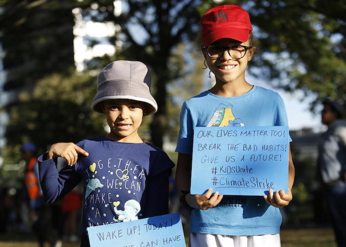 On 20 September 2019 in New York City, (left) Ellie, 8, and her sister Lena, 10, join other youth climate activists in a demonstration calling for global action to combat climate change.