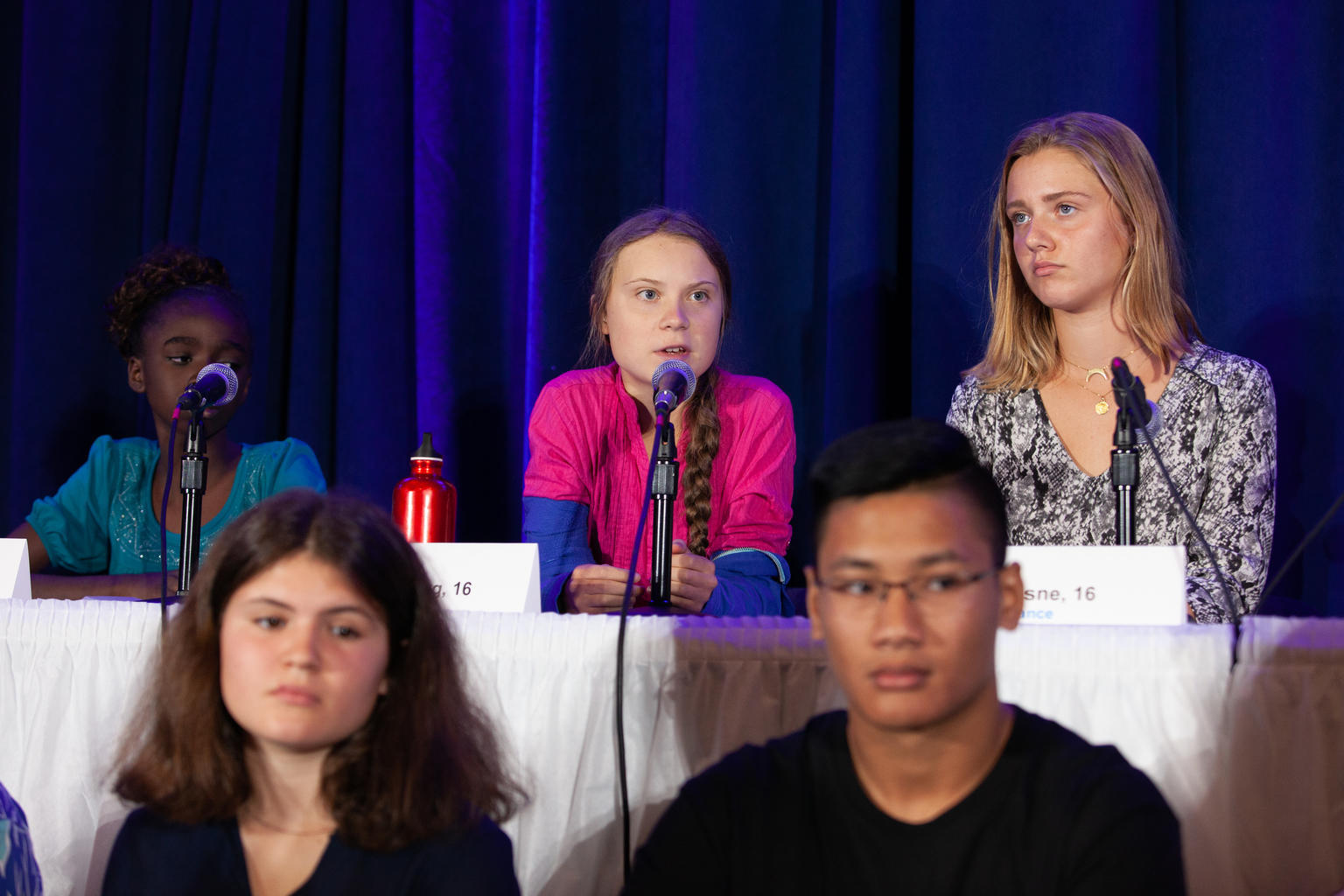 """In September 2019, a 16-year-old Greta Thunberg (center) spoke at UNICEF House in New York at a press conference announcing young people's determination to take collective action to address the impacts of the climate crisis. """"I'm doing this because world"""