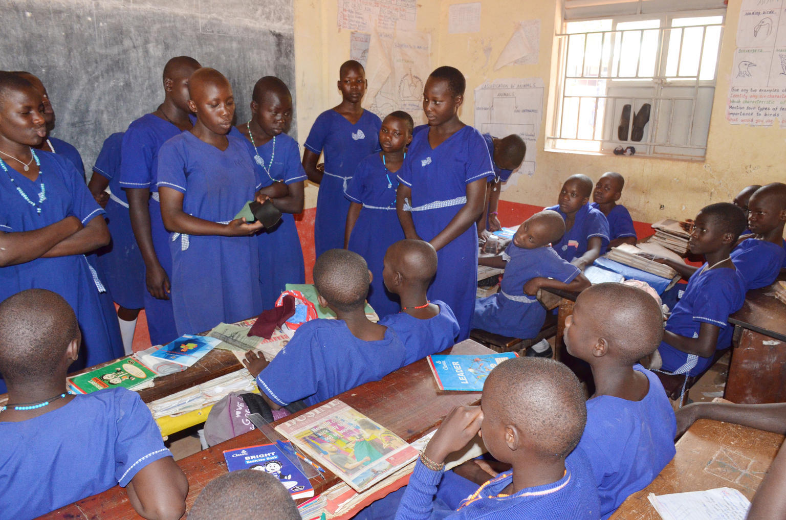 Students at Morulem Girls Primary School in Abim District, in Northern Uganda, teach younger students about menstrual hygiene management. © UNICEF/UNI210169/Adriko