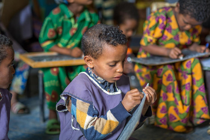 A boy practices his writing skills at UNICEF-supported Mequat Primary School in Ethiopia's Tigray region.