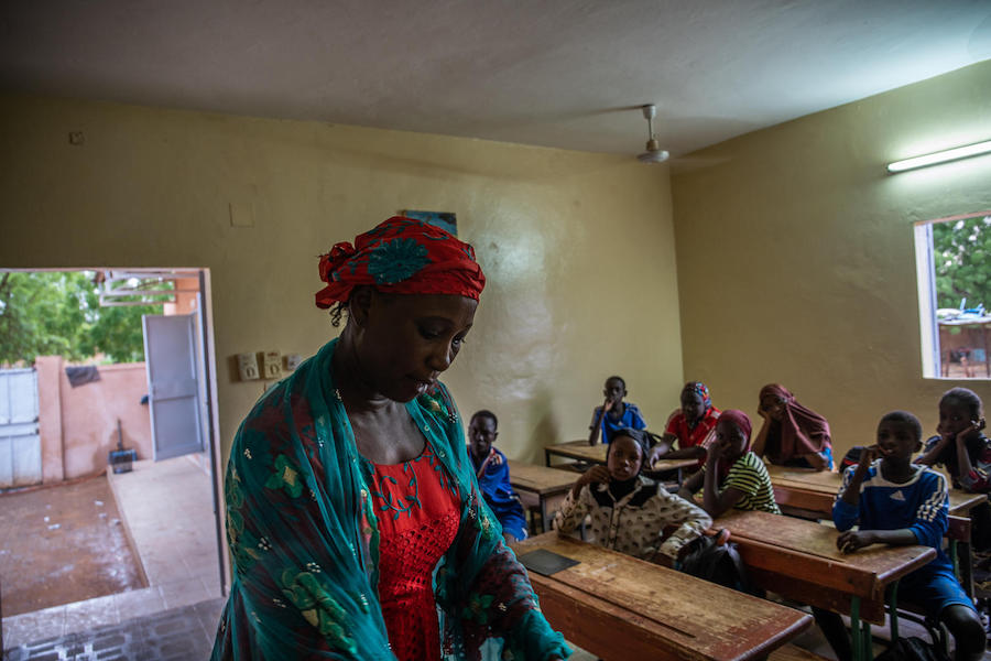 Garba Rahama, left, teaches at a UNICEF-supported primary school in Niamey, Niger.