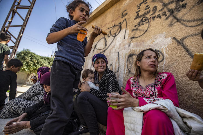 Syrian Arab and Kurdish civilians arrive to Hassakeh city after fleeing following Turkish bombardment on Syria's northeastern towns along the Turkish border on October 10, 2019.