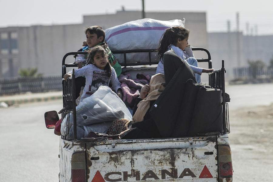 In October 2019, families continue to flee escalating violence in northeast Syria.