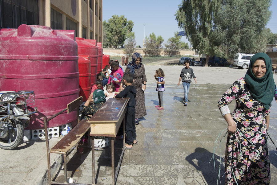 In October 2019 in Tal Tamer and Hasakeh city, northeast Syria, UNICEF and partners are reaching families in collective shelters in with safe water supply through water trucking.
