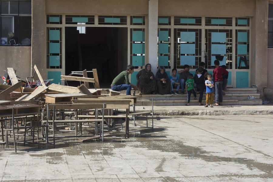 Many displaced families in northeast Syria are staying in collective shelters in schools and unfinished buildings.