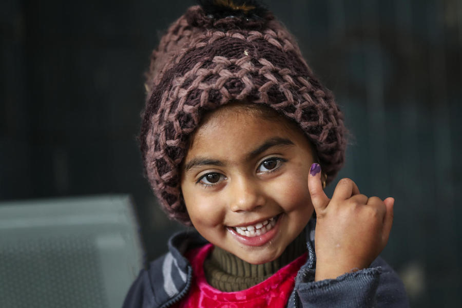 Ajwa, 4, shows the ink mark on her little finger confirming she has received the polio vaccine at Lahore railway station in Lahore Punjab Province, Pakistan in January 2019.