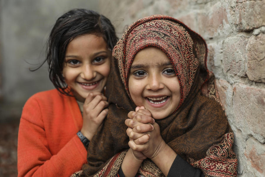 Anessa (right) and Rashida stand outside their home in Dara Chaudhry Kamran, Lahore Punjab Province, Pakistan in January 2019.