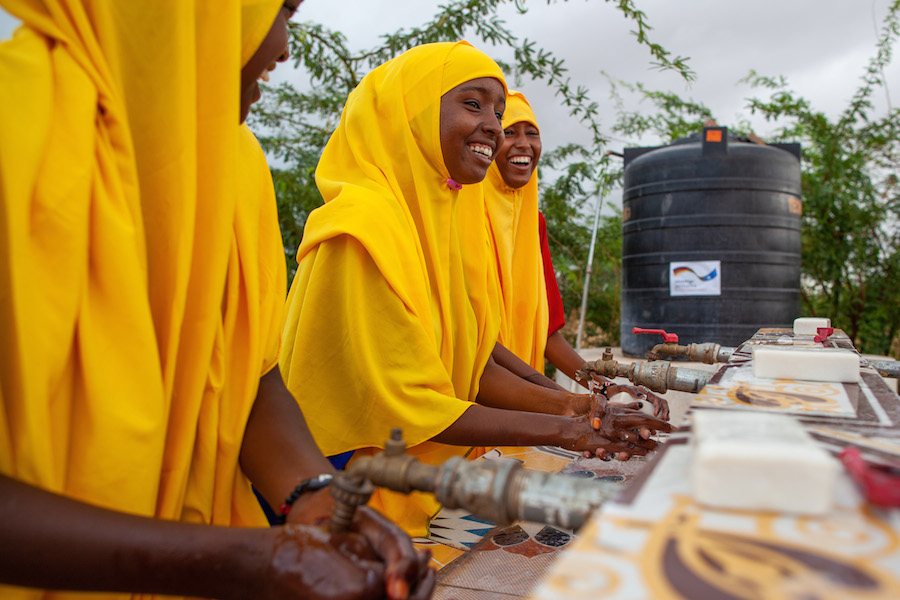 UNICEF works with partners to ensure that schools serving vulnerable populations — such as the Qansahley Primary School in Dollow, Somalia — have adequate facilities to support healthy hygiene practices, like washing up before meals.