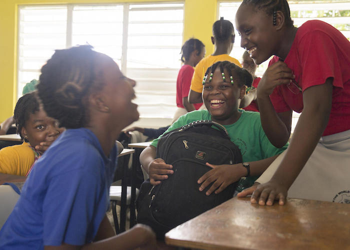 Eleven-year-old Jerrene (center) shares a laugh with fellow students at Princess Margaret Secondary School in St. John's, Antigua in 2019.