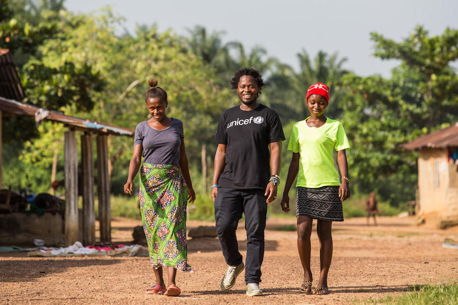On November 20, 2019, former child soldier and UNICEF Goodwill Advocate for Children Affected by War Ishmael Beah met with orphaned cousins Isatu, 17 (left) and Fatmata, 15, in Sierra Leone.