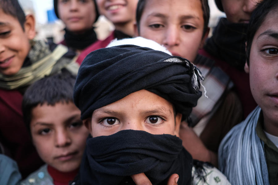 On 22 November 2019, a group of boys stand outside Shaheed Abdul Ahad Khan Karzai Orphanage in Kandahar, Afghanistan.