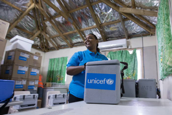 Dr. Frances Vulivuili, UNICEF Health and Nutrition Specialist, prepares cold boxes for vaccination teams at Tupua Tamasese Meaole Hospital in Apia, Samoa.