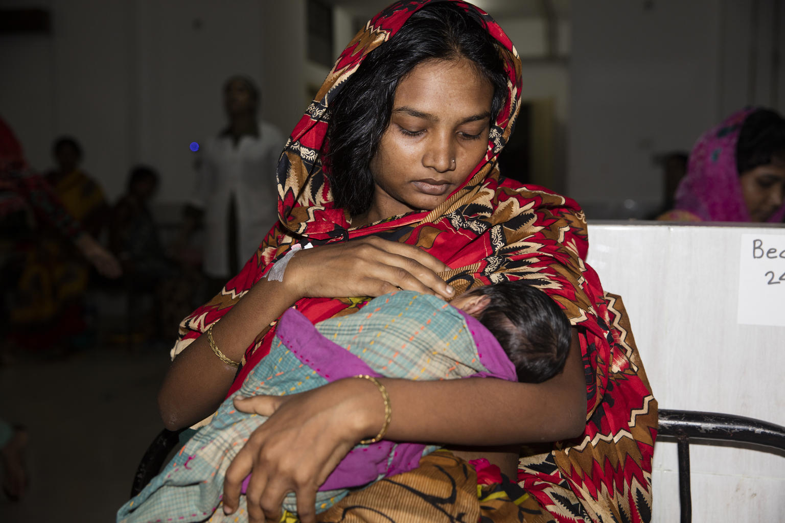 Ayesha Siddqa (18) practices breast feed her child in the women ward at Cox's Bazar Medical Hospital on 19 October 2017 in Cox's Bazar.