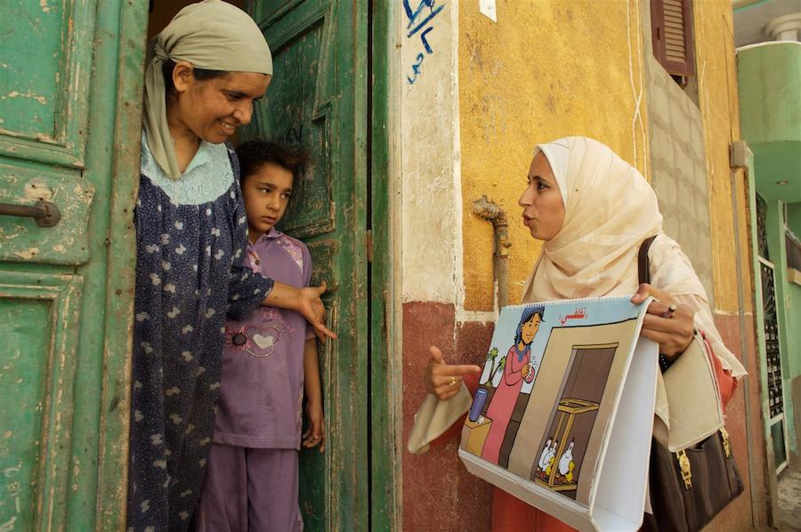 A UNICEF-trained community health worker makes a home visit to a family in Egypt with information about how to prevent the spread of avian flu.