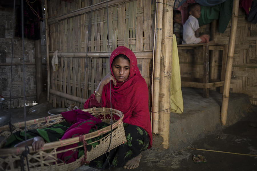 On 2 December 2019, at Balukhali refugee camp in Cox's Bazar, Bangladesh, Kulsum Bahar, 27, holds two dresses belonging to her daughter, Jannatara, 8, who went missing fourteen months ago on her way from their home to a learning center in the camp.