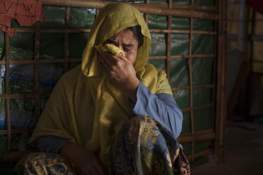 On December 1, 2019, at Balukhali refugee camp in Cox's Bazar, Bangladesh, Fatima Begum cries in her home as she speaks about the disappearance of her daughter, Jannat Ara, 16, who went missing nine months ago.