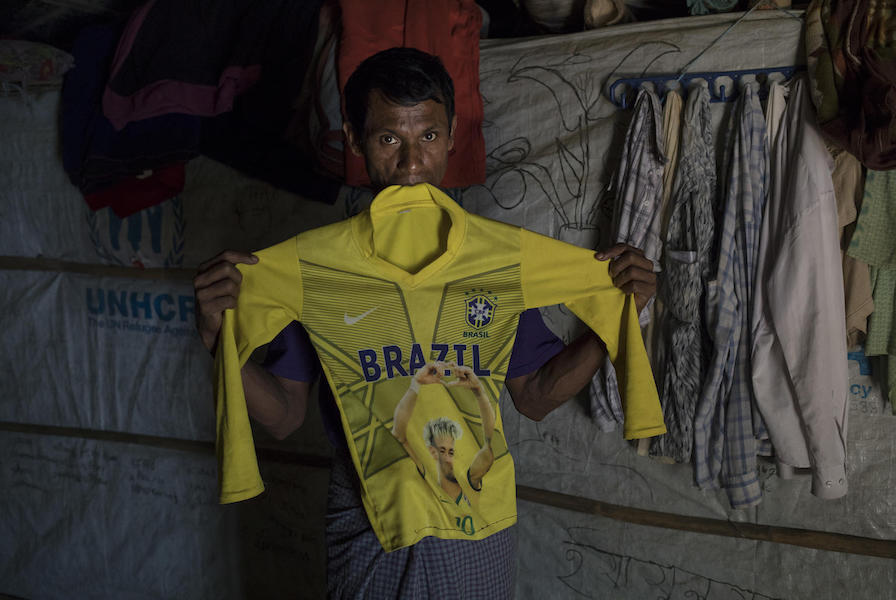 On December 1, 2019, Salim Taallah, 52, holds the football jersey of his son, Korimullah, 12, who went missing six months ago when he went a short distance from the family's home to play, in Balukhali refugee camp in Cox's Bazar, Bangladesh.