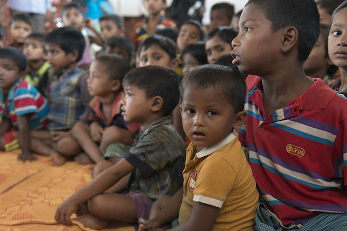 Rohingya refugee children gathered at a UNICEF-supported learning center inside the Balukhali Camp, Cox's Bazar, Bangladesh.
