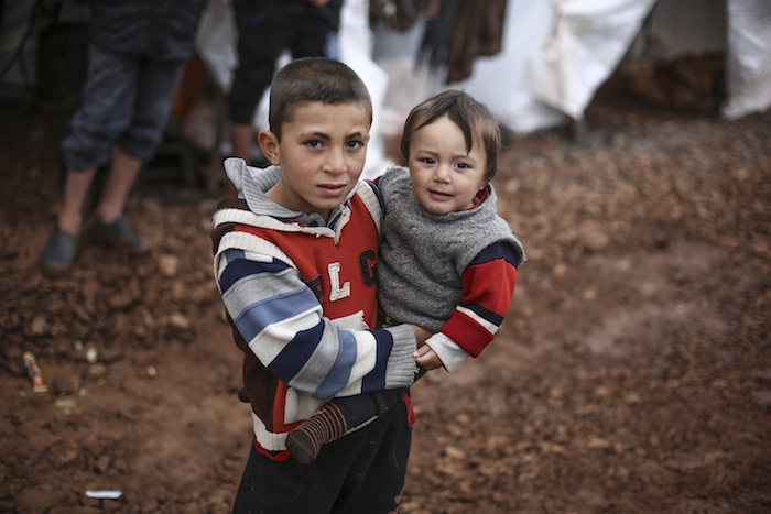 Displaced Syrian children staying in an informal tented settlement, near Alqah village, close to the Syrian-Turkish border, northwest Syria.