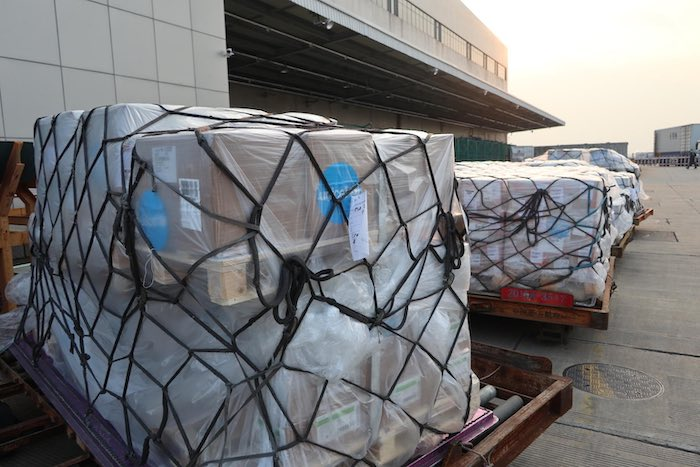 UNICEF supplies – 10,861 protective suits, 1,577 surgical masks and 18,371 respiratory masks – on arrival in late January at Pudong International Airport in Shanghai to support China's response to the novel coronavirus. © UNICEF/UNI284466/