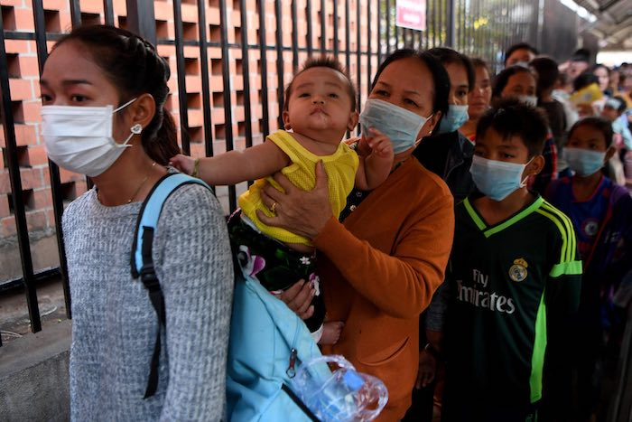 In Cambodia in late January, after the first case of novel coronavirus was reported in the country, people, like these women outside a Phnom Penh children's hospital, began wearing face masks. Despite popular belief, masks should only be worn by people wh