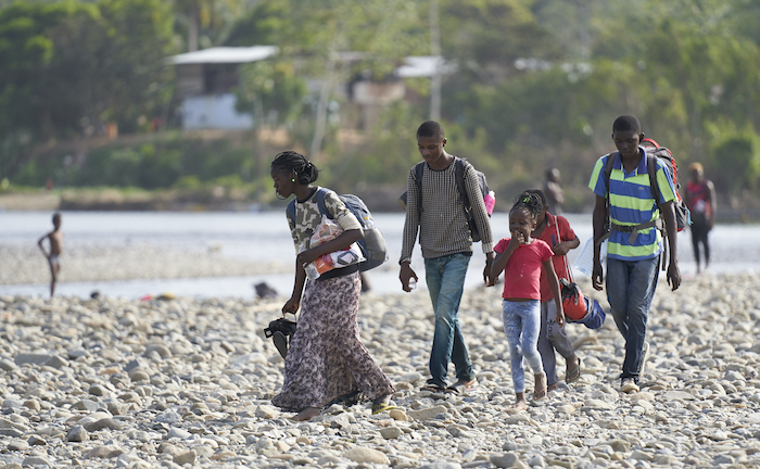 A migrant family on the move completes a treacherous river crossing to enter Panama, a country of transit for those making their way north in search of a better life.
