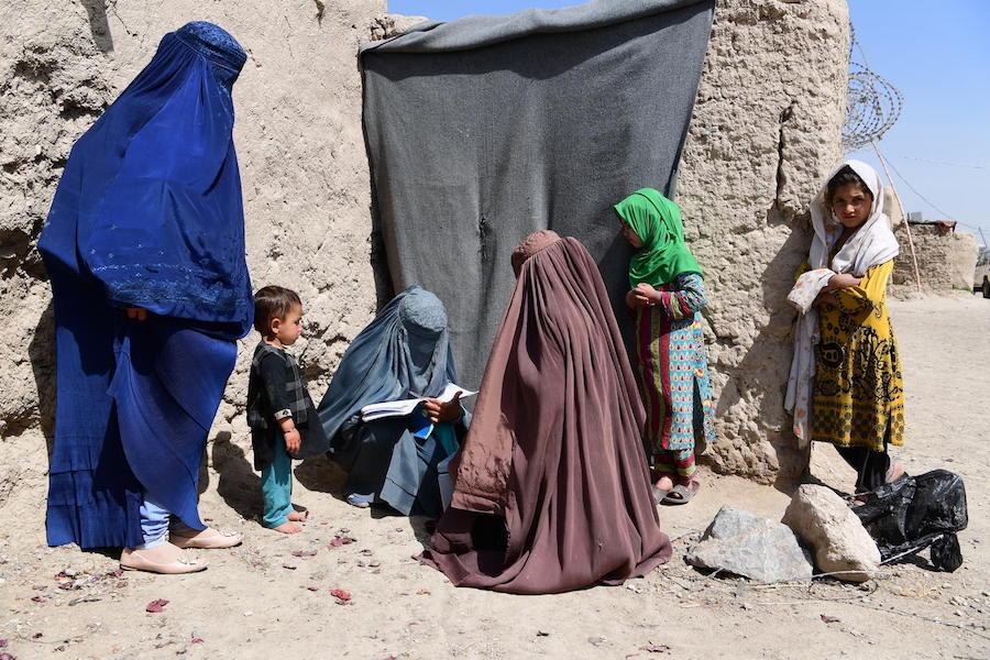 A child is being vaccinated against polio, during a polio social mobilization activity in the community, in Kandahar, Afghanistan.