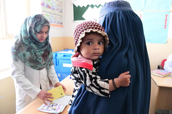 A mother and child visit the UNICEF supported Adam Darmal Clinic in Kandahar, in the southern region of Afghanistan.