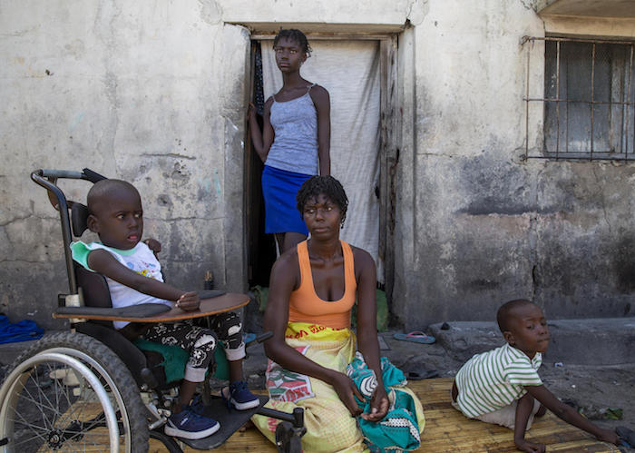 Aissa Vali (center) with her daughter Anna and her twins, Elias (left) in his wheelchair that was provided by UNICEF, and Lazarus, at their home in Beira, Mozambique, on March 6, 2020.