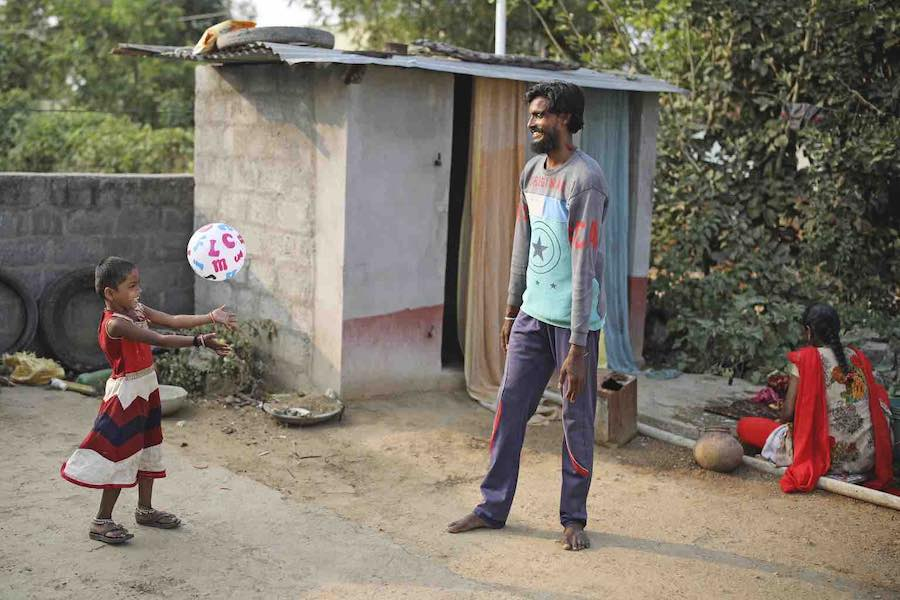 Rishitha, who lives in the village of Perleakondaram in India is pictured playing with her dad at home.