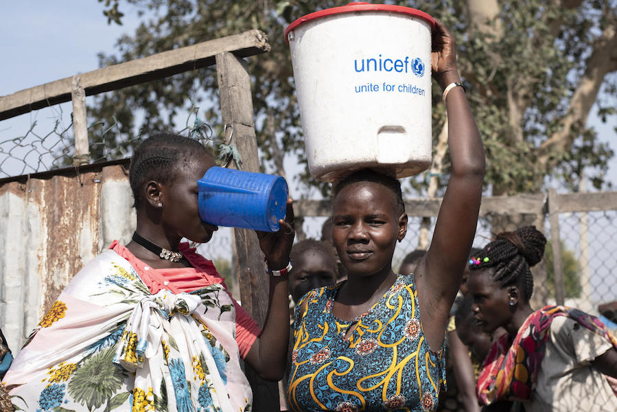 Families can fill their buckets with safe drinking water at one of the 16 water points near the UNICEF-supported Rubkona water treatment facility in South Sudan.
