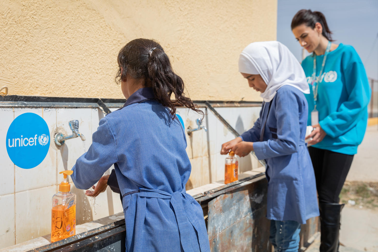 Students at the Al khader primary school in Jordan practice proper handwashing, one of the most effective ways to prevent COVID-19. UNICEF helped create an Environmental Action Club at the school and is working across Jordan to provide safe water