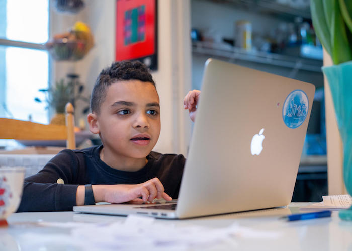 On the morning of 17 March 2020 in Connecticut, United States of America, Luka, 8, completes a reading assignment as part of his second grade class's distance learning assignments.