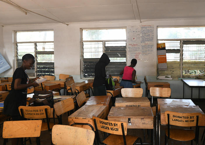 On 16 March 2020, in Nairobi, Kenya, school children pack their books to take home, following a directive by the government suspending learning in all of the country's educational institutions as a preventive measure against the spread of the coronavirus.