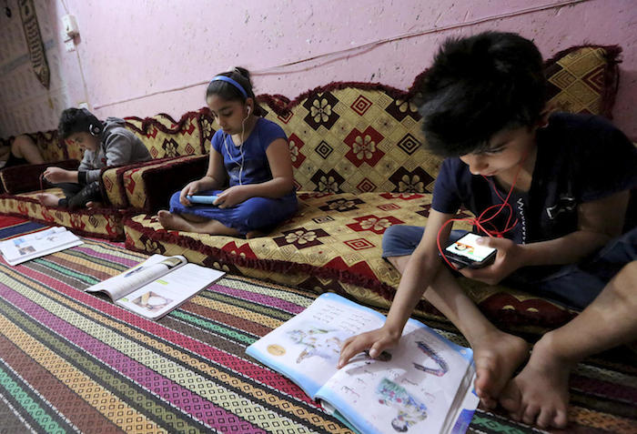 Iraqi children take their lessons remotely in Baghdad amidst a lockdown to fight the spread of the coronavirus COVID-19.