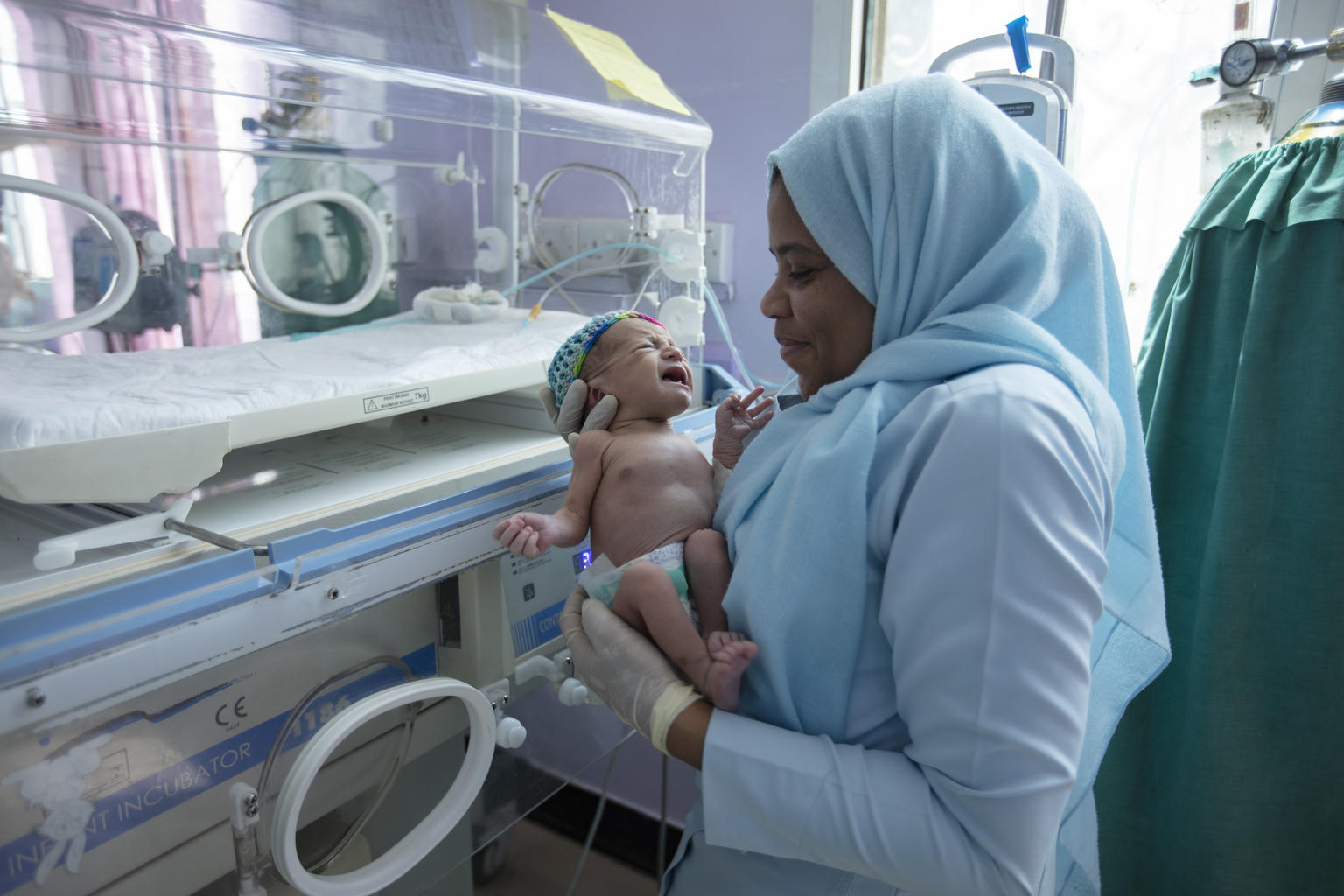 On 23 October 2019, nurse Hindia Al-Zoubah checks on a 5-day-old baby girl who is making good progress in the neonatal intensive care unit at the Al Sabeen Maternal Hospital in Sana'a, Yemen.